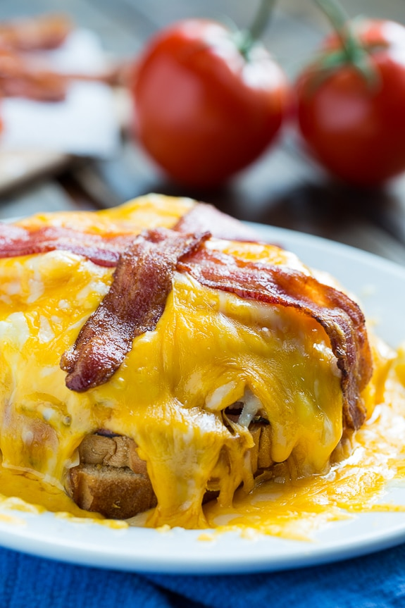 Kentucky Hot Brown with turkey, ham, tomato, a cream gravy, a mound of melted, gooey cheese, and bacon. What a sandwich!