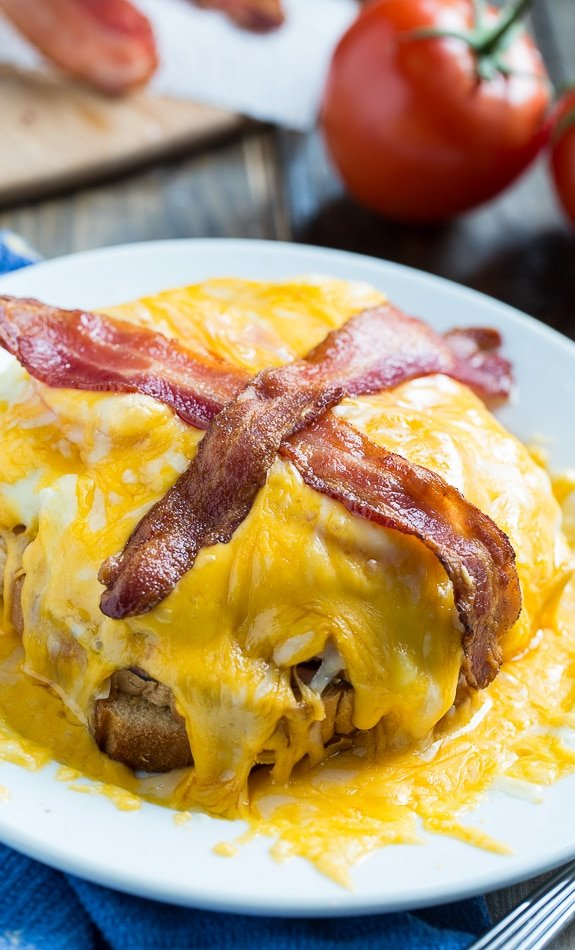 The Kentucky Hot Brown is a Kentucky original. This one is similar to the Hot Brown served at Ramsey's Diner in Lexington. It has turkey, ham, and tomato topped with a cream gravy and covered in a mound of melted cheddar. Topped with bacon. What a sandwich!