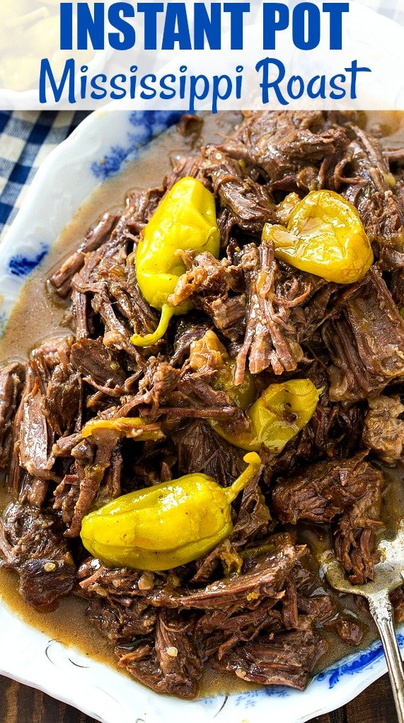 Shredded Roast on a serving platter with pepperoncini peppers.