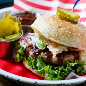 Southern BBQ Pork Burgers with creamy coleslaw and BBQ sauce.