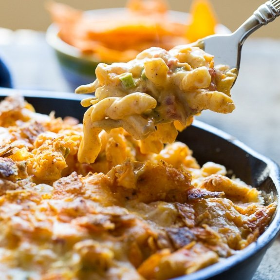 King Ranch Casserole in mac and cheese form. Spicy and creamy with diced chicken and a crushed dorito topping.