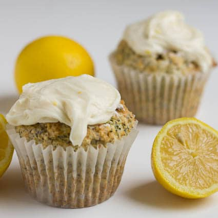 Two Lemon Muffins with lemons halves.