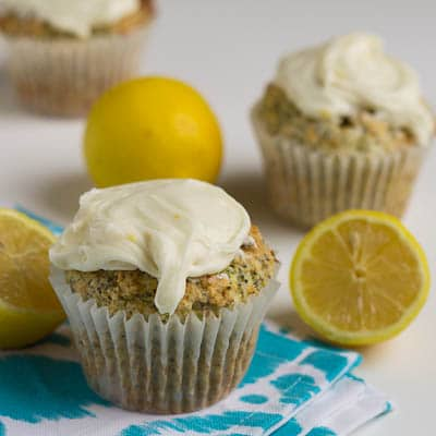Lemon Poppy Seed Muffins surrounded by lemon halves.