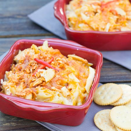 Two small red casserole dishes full of Pimento Mac and Cheese.