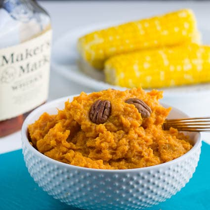 Bourbon Mashed Sweet Potatoes in a white bowl.