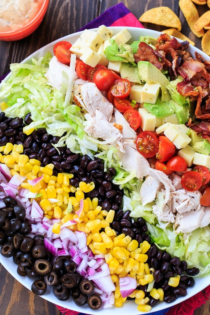Tex-Mex Cobb Salad with black beans, corn, avocado, bacon, chicken, and frito corn chips