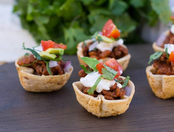 Taco Cups with cilantro in background.