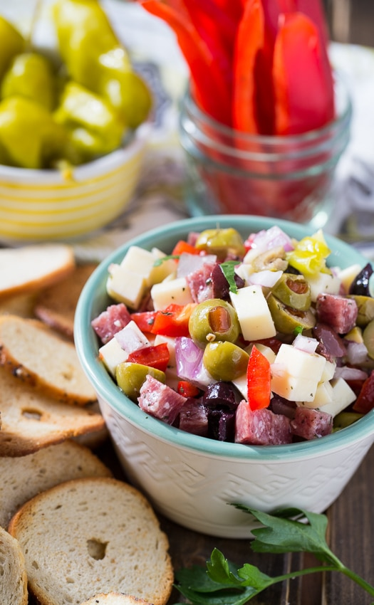 Muffaletta Dip with salami, cheese, and olives. An easy make ahead party food.