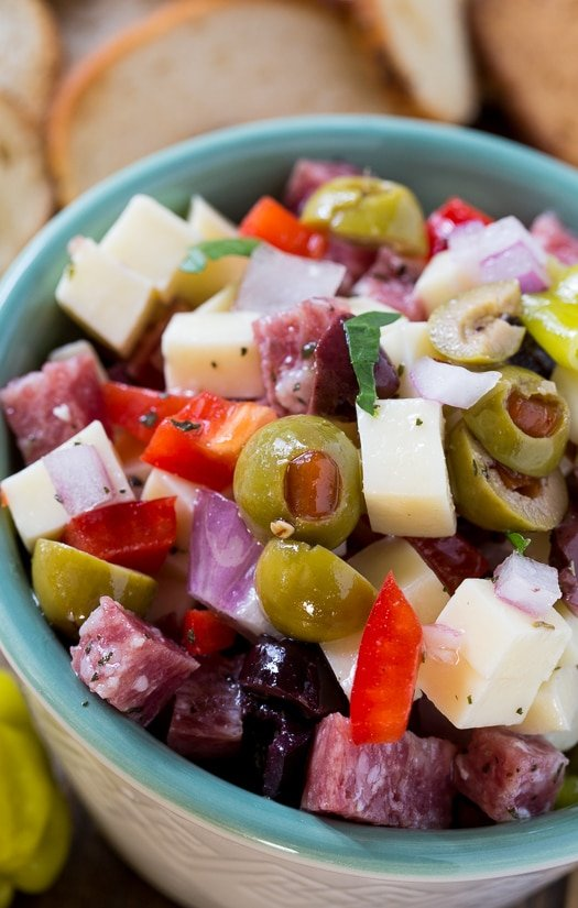Muffaletta Dip with cheese, salami, and olives. An easy make ahead party food.