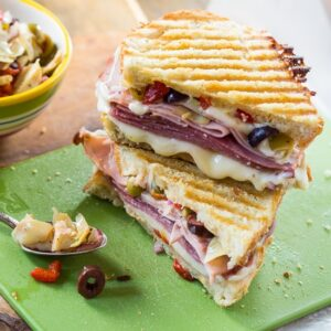 Muffaletta Panini with 3kinds of meat, provolone cheese, and olive relish.