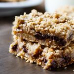 Oatmeal Carmelitas - chocolate chips and caramel sandwiched between oatmeal cookie dough layers.