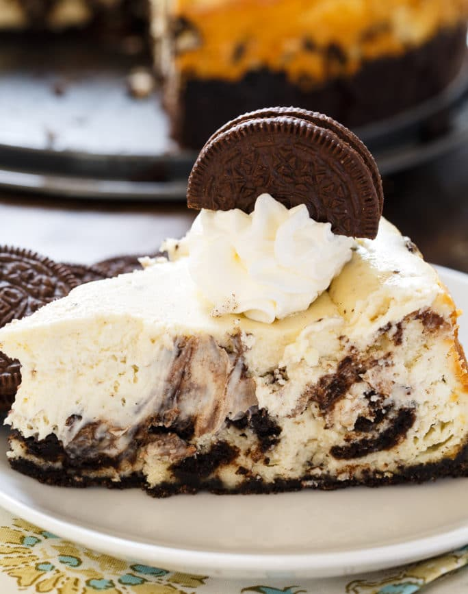 Oreo Cheesecake is super creamy with lots of oreo cookie chunks.
