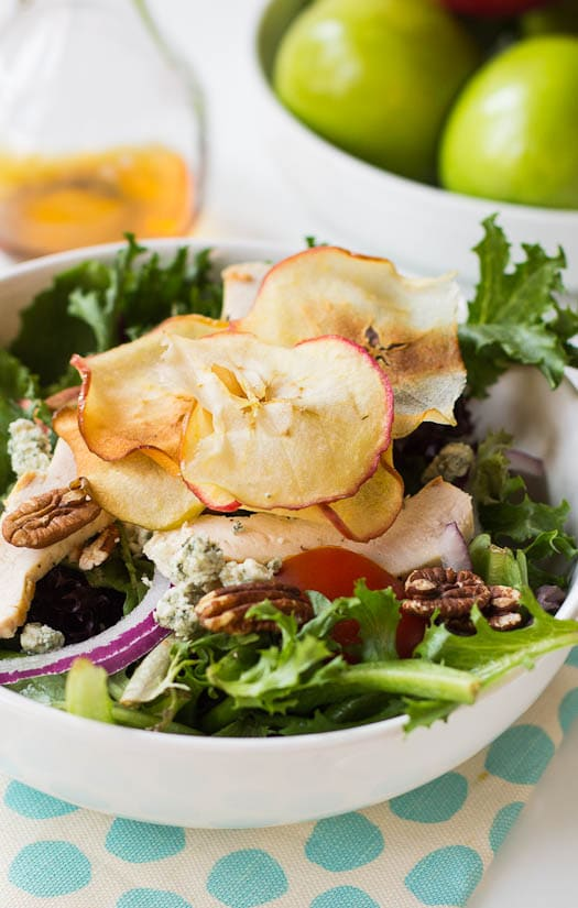 Cloes-up of salad with apple chips on top.