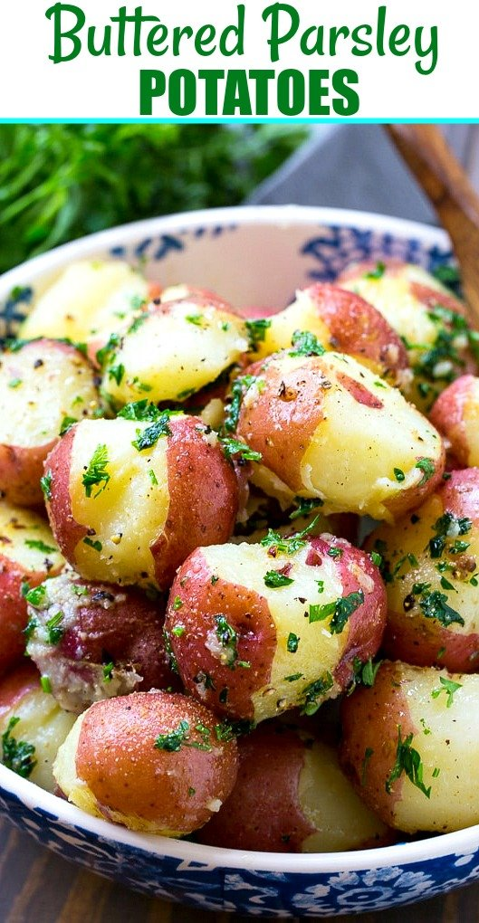 Potatoes covered with chopped parsley in a serving bowl.
