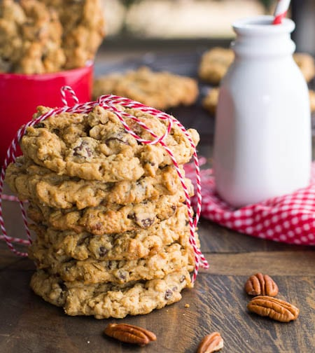 Stack of cookies with glass milk bottle in background.