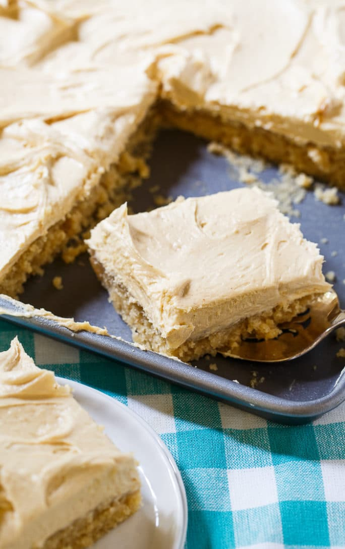 Peanut Butter Sheet Cake with a fluffy peanut butter frosting. Love this for potlucks!