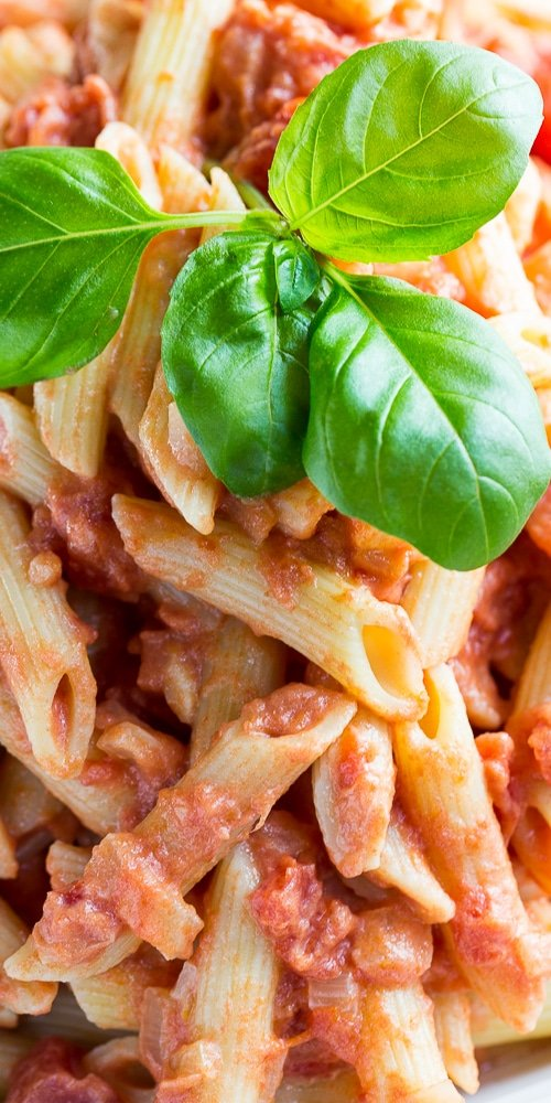 Close-up of Penne Alla Vodka with fresh basil.
