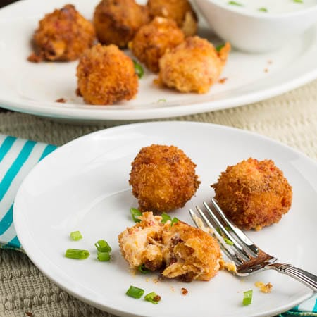 Fried Pimiento Cheese Balls on a plate with a platter in the background.