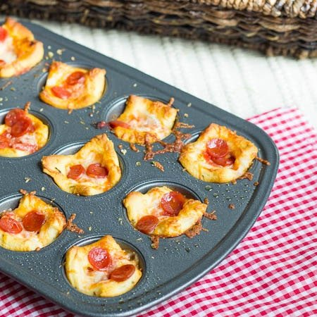 Crescent Roll Pizza Poppers in a mini muffin tin.