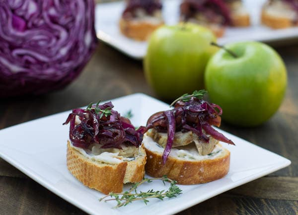 Two Pieces of Pork Crostini on a square plate.