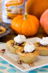 Pumpkin Pecan Tassies in a sugar cookie crust