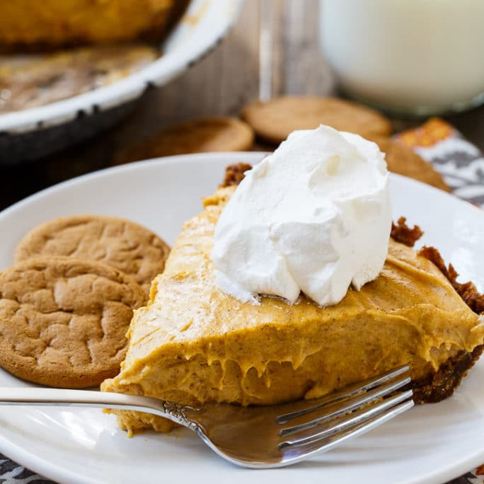 Slice of Marshmallow Pumpkin Pie topped with whipped cream.