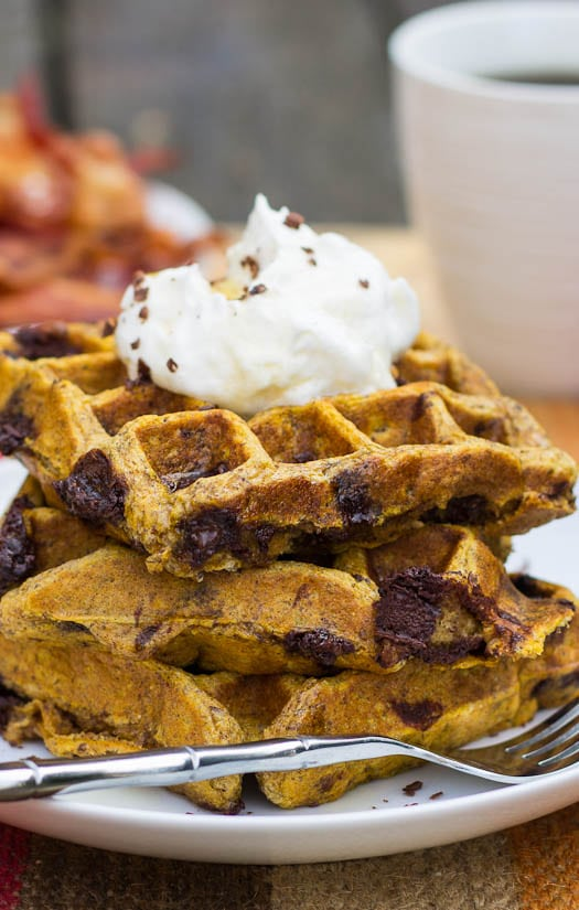 Close-up of Pumpkin-Chocolate Chip Waffles stacked on a plate.