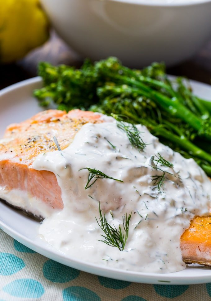 Baked salmon covered in a creamy dill sauce.