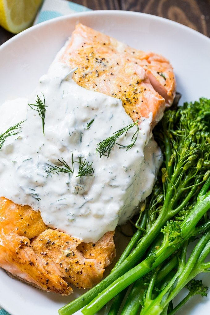 Salmon is baked in the oven and covered with a creamy dill sauce.