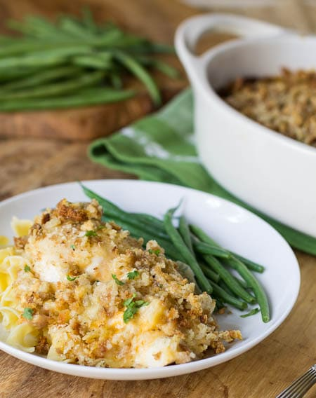 Baked Chicken with Stuffing Mix on a plate with green beans.