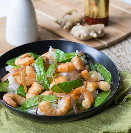 Gingered Stir Fry with Shrimp and Snow Peas in black bowl.