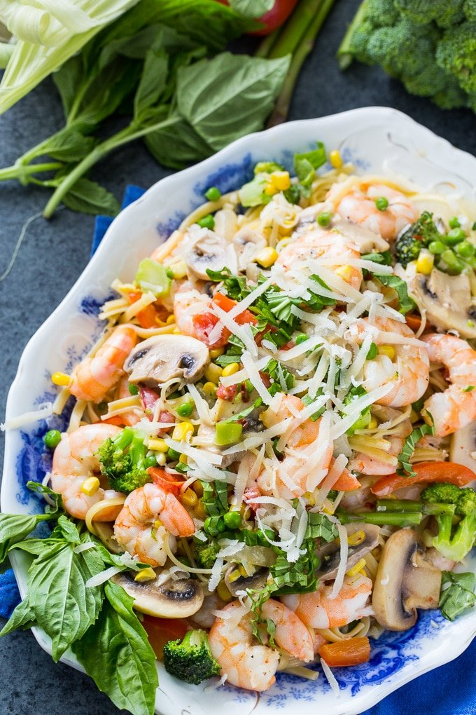Shrimp Pasta Primavera with lots of fresh vegetables in a creamy sauce.
