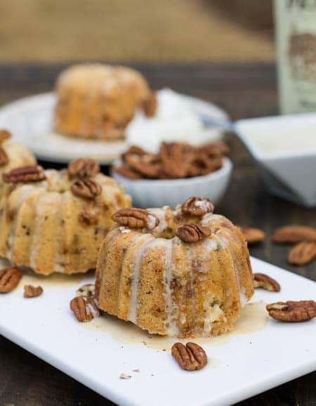 Mini Bundt Cakes with glaze dripping down.