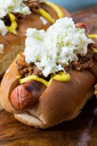 Southern-Style Slaw Dogs with mustard and homemade chili.
