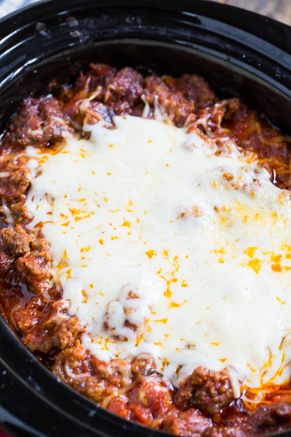 Slow Cooker Lasagna with lots of sausage. You won't believe how good this easy lasagna is!