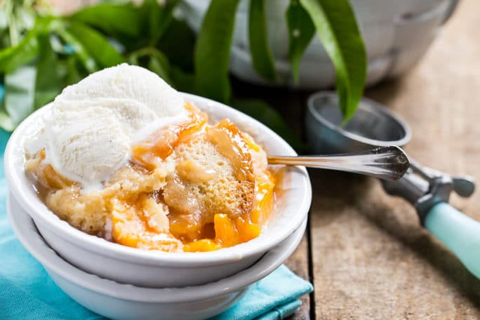 Slow Cooker Peach Cobbler- make with fresh or frozen peaches.