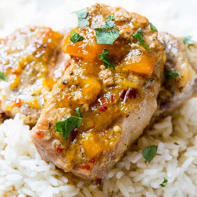 Slow Cooker Spicy Peach Glazed Pork Chops