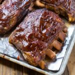 Slow Cooker ribs are so easy, tender, and delicious. A quick broil at the end makes them super flavorful!