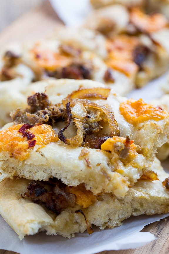 Southern-Style Focaccia with pulled pork, pimento cheese, and vidalia onion.