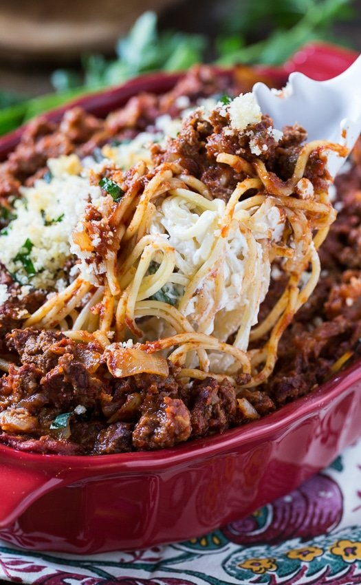 Spaghetti Beef Casserole with a layer of cream cheese and a buttery bread crumb topping.