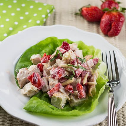 Chicken Salad with Strawberries on a leaf of lettuce.