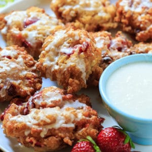 Glazed Strawberry Fritters are crisp on the outside with chunks of fresh strawberry on the inside.