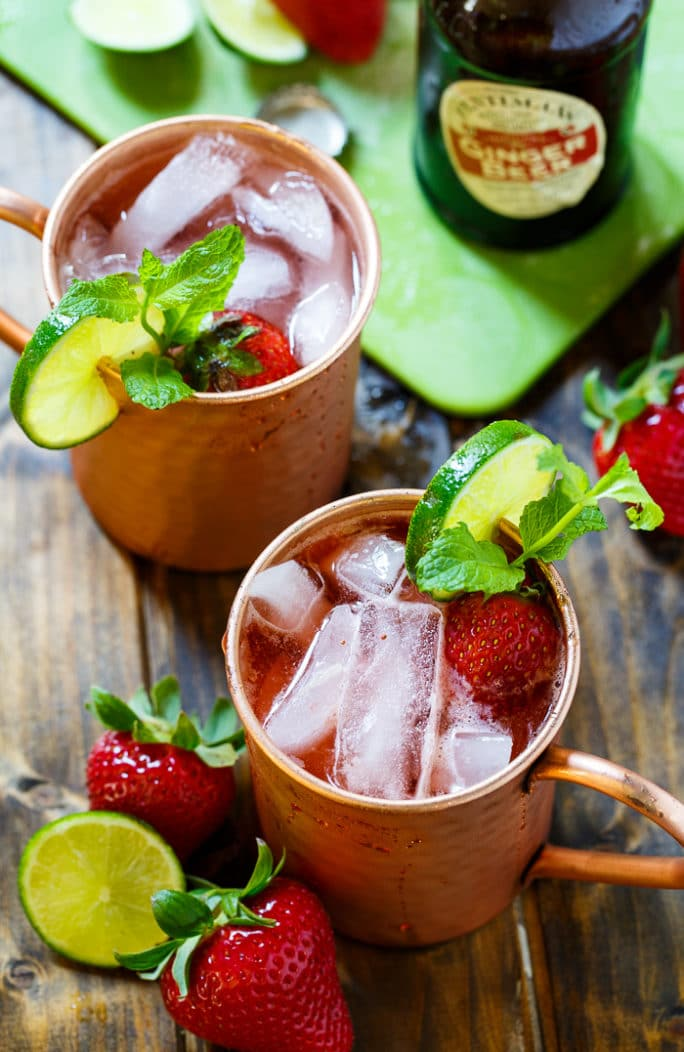 Strawberry Moscow Mules- a combo of ginger beer, vodka, lime juice, and strawberries makes a super refreshing summer drink!