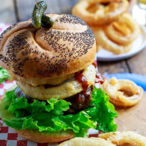 Cowboy BUrgers topped with bacon, onion rings, and bbq sauce.