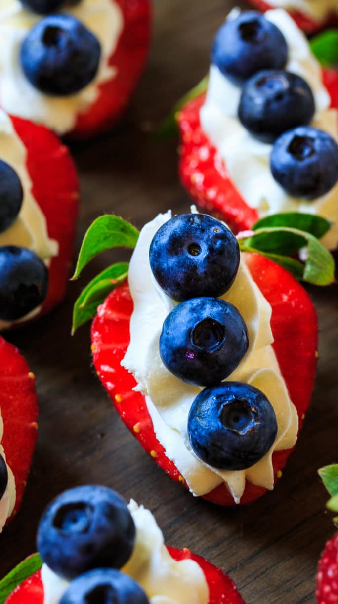 Red, White, and Blue Cheesecake Strawberries make a festive 4th of July treat.