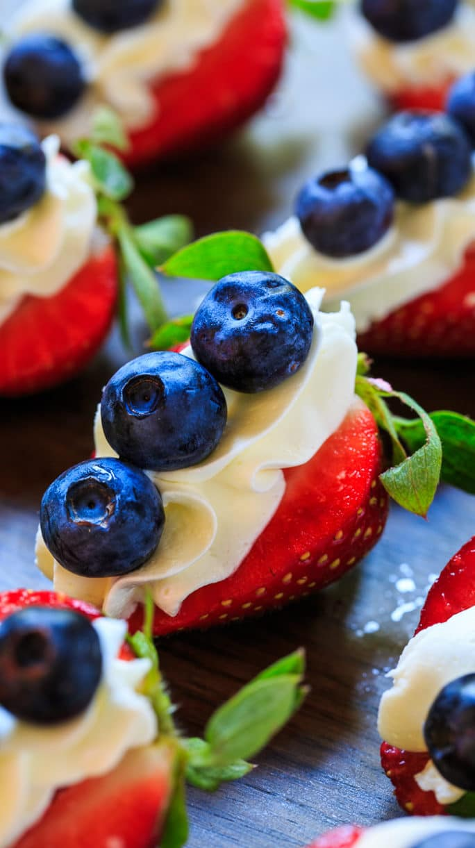 Red, White, and Blue Cheesecake Strawberries make a healthier dessert for a 4th of July party.