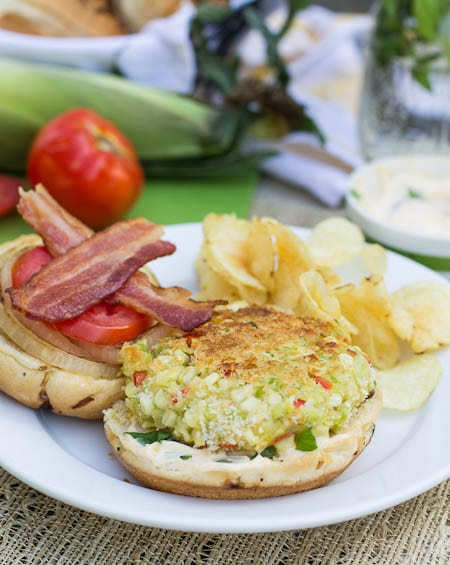 Succotash Burger on a plate with potato chips.