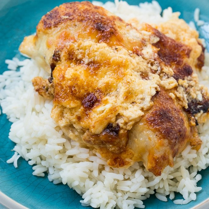 Creamy Baked Swiss Chicken served over rice