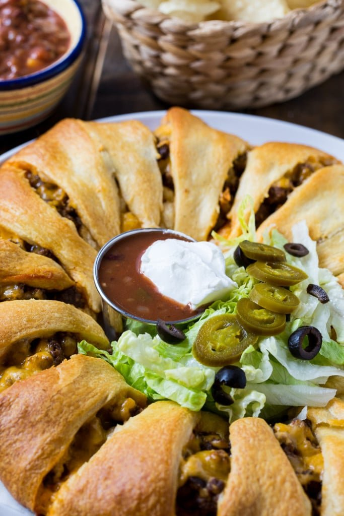 Taco Ring made with refrigerated crescent roll dough. Makes a great family meal or game day snack.