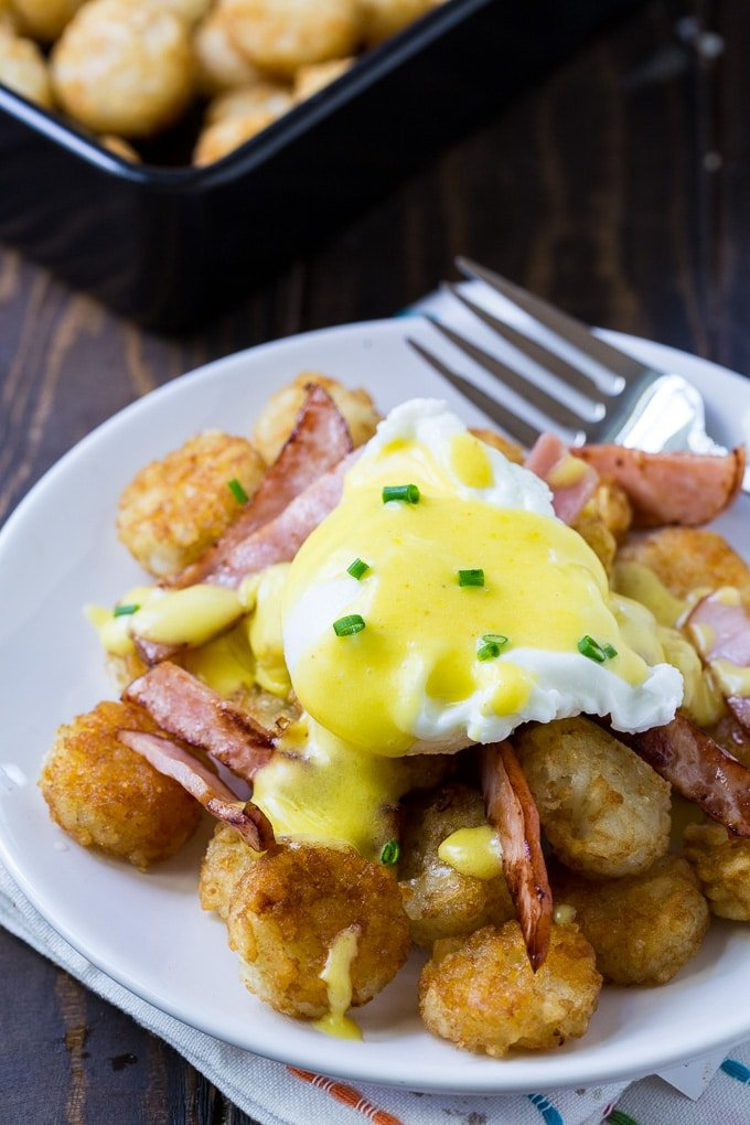 Tater Tor Eggs Benedict on a crispy bed of tater tots with canadian bacon.
